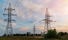 Distribution electric substation with power lines and transformers. At sunset royalty free stock image