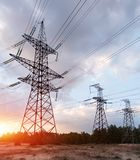 Distribution electric substation with power lines and transformers. At sunset stock image