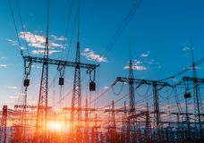 Distribution electric substation with power lines and transformers, at sunset. Royalty Free Stock Photography