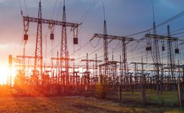 Distribution electric substation with power lines and transformers, at sunset. Distribution electric substation with power lines and transformers, at sunset royalty free stock photo