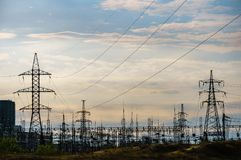 Distribution electric substation with power lines and transformers, at sunset.  royalty free stock images