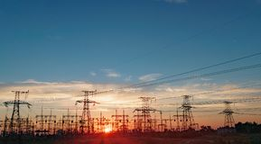 Distribution electric substation with power lines and transformers, at sunset. Distribution electric substation with power lines and transformers royalty free stock photography