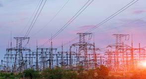 Distribution electric substation with power lines and transformers, at sunset. Distribution electric substation with power lines and transformers stock photos