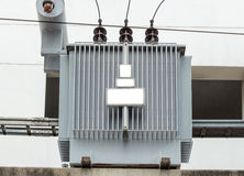 Distribution electrical transformer. On concrete stand Stock Photo