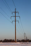 Distribution electricity. The photo shows the supports of power lines Royalty Free Stock Photography