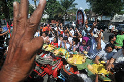 Distribution of free food to the poor people Stock Photography