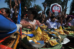 Distribution of free food to the poor people Stock Photo