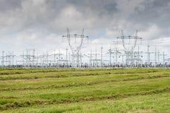 Distribution Power Plant. Green grass and blue sky.  Power line Stock Photos