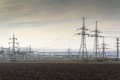 Distribution power station with electricity pylons and dramatic cloudy sky Stock Photo