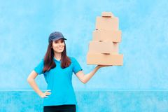 Distribution Service Delivery Worker Holding Many Cardboard Packages. Employee holding and handling parcel boxes stock image