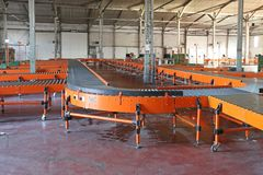 Distribution Sorting Warehouse. Conveyor Roller Sorting System in Distribution Warehouse stock image