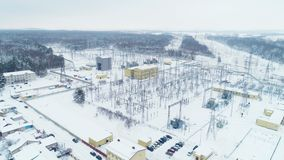 Distribution station with buildings and structures holding wires. Impressive aerial view distribution station with yellow buildings and metal structures holding stock video