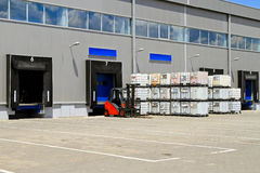Distribution warehouse. Forklift vehicle in front of cargo doors at distribution warehouse stock photo