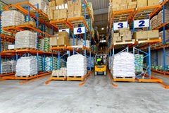 Distribution warehouse. Interior with racks and shelves Royalty Free Stock Images