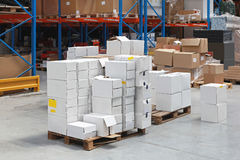 Distribution Warehouse. Pile of boxes at pallets in distribution warehouse Stock Photo