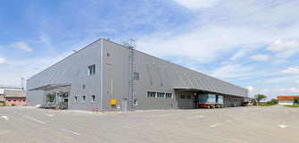 Distribution warehouse. Big gray distribution warehouse building royalty free stock photos