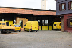 Distribution warehouse factory with vans and rucks in a row Stock Photography