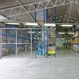 Distribution Warehouse. Fenced Safety Storage Room and Distribution Warehouse stock photo