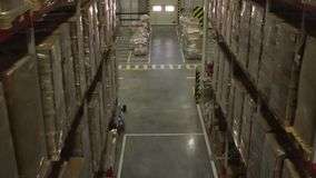 Distribution Warehouse Interior. Shelves and racks in distribution warehouse interior.Rows with cardboard boxes and goods at shelves.Logistic, transportation and stock video