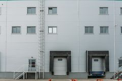 Distribution warehouse and logistics building exterior with gates, copy space.  royalty free stock image
