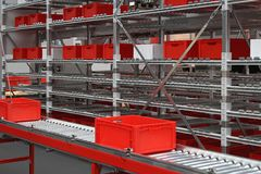 Distribution warehouse. Red crates at conveyor rollers in distribution warehouse stock images