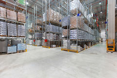 Distribution warehouse. Shelves with goods in distribution center warehouse stock images