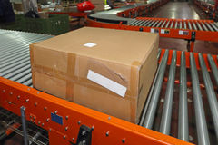 Distribution Warehouse. Shipping Box at Conveyor Belt in Distribution Warehouse stock photography