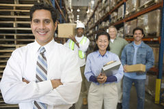 Distribution Warehouse Staff. Portrait of multiethnic workers in distribution warehouse stock photos