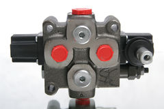 Distributor. Electro-hydraulic distributor with back and red elements made from metal Stock Images
