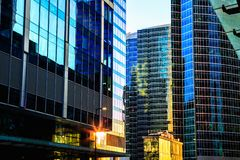 District of glass business centers. Modern skyscrapers. Skyscrapers on city street. District of glass business centers. Modern office buildings reflecting blue stock photos
