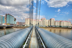 District heat pipes crossing river Royalty Free Stock Images