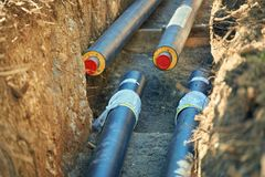 District heating - connecting insulated pipes. District heating is a system for distributing heat generated in a centralized location for residential and royalty free stock images