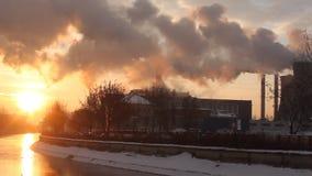 Smoke at sunrise - a frosty winter morning