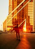 District Moscow city. Business centre. Offices in skyscrapers. Young girl enjoys the sun stock images