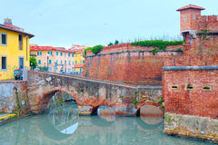 District of New Venice, Livorno, view of the island of New Fortress surrounded by the Royal Canal and the bridge with three arches. That connects Stock Photo