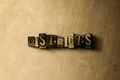 DISTRICTS - close-up of grungy vintage typeset word on metal backdrop Royalty Free Stock Photography