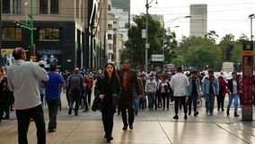 People walk on the pedestrian crossing of Mexico City. Distrito Federal, Mexico City, July 24, 2019 - People walk on the pedestrian crossing on a cloudy and gray stock video footage