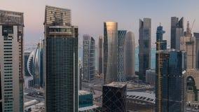Distrito financiero céntrico y central del lapso de tiempo de la salida del sol encima, Doha almacen de metraje de vídeo