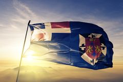 Distrito Nacional Province of Dominican Republic flag textile cloth fabric waving on the top sunrise mist fog. Beautiful royalty free stock photography