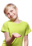 Distrust, doubt, skepticism. The boy smiles slyly, arm extended. Skepticism and doubt Stock Photos