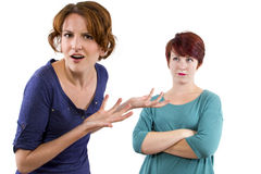 Distrust. Two Caucasian women arguing and distrusting each other Royalty Free Stock Images
