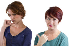 Distrust. Two Caucasian women arguing and distrusting each other Royalty Free Stock Image