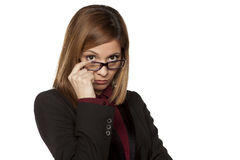 Distrustful business woman. Worried business woman with eyeglasses looking with distrust on a white background Royalty Free Stock Photo