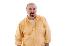 Distrustful sceptical middle-aged man. With a goatee standing looking sideways to the right of the frame with a speculative look, part of a series on body Stock Images
