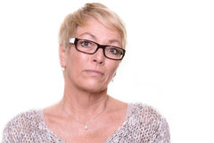 Distrustful stern middle-aged woman Stock Photos