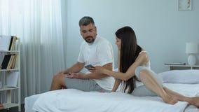Distrustful wife checking spouses mobile phone seeking jealousy reason, marriage. Stock footage stock footage