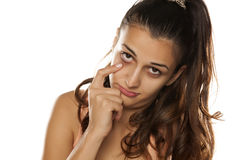 Distrustful woman Stock Images