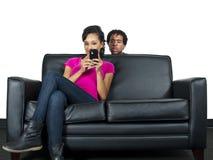 Distrusting boyfriend royalty free stock photography