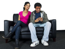 Distrusting girlfriend. Is snooping on guy's text messages stock photo