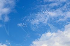 Disturbance in the universe backgroundof blue sky with clouds and circular vortex stock photos